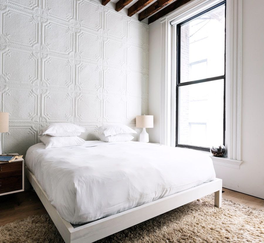 Le Fashion Blog A Fashionable Home Neutral Chic Bedroom New York City Textured Wall Tile Shag Rug Exposed Beams Via One Fine Stay