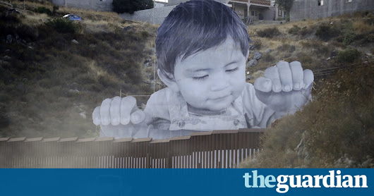 Giant portrait of toddler peers over US-Mexico border wall | World news | The Guardian