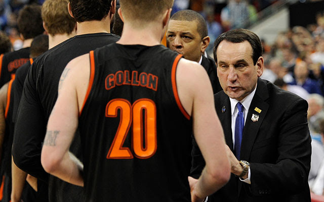 Coach K did the handshake line on the court, then had kind words in the Mercer locker room. (Getty Images)