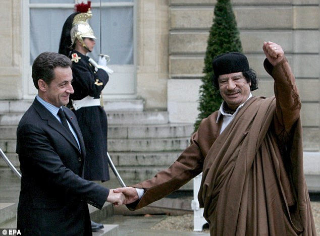 Former Libyan leader, Colonel Gaddafi being welcomed to Elysee Palace by Nicolas Sarkozy when he was President
