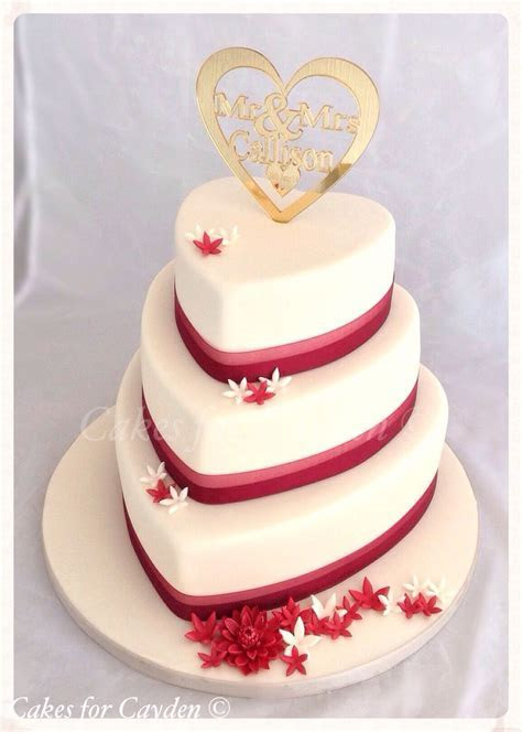 Ivory & burgundy heart shape wedding cake with scattered