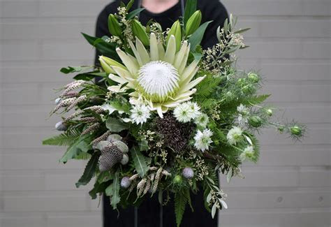 Industrial Bridal Bouquet   The White Orchid Floral Design