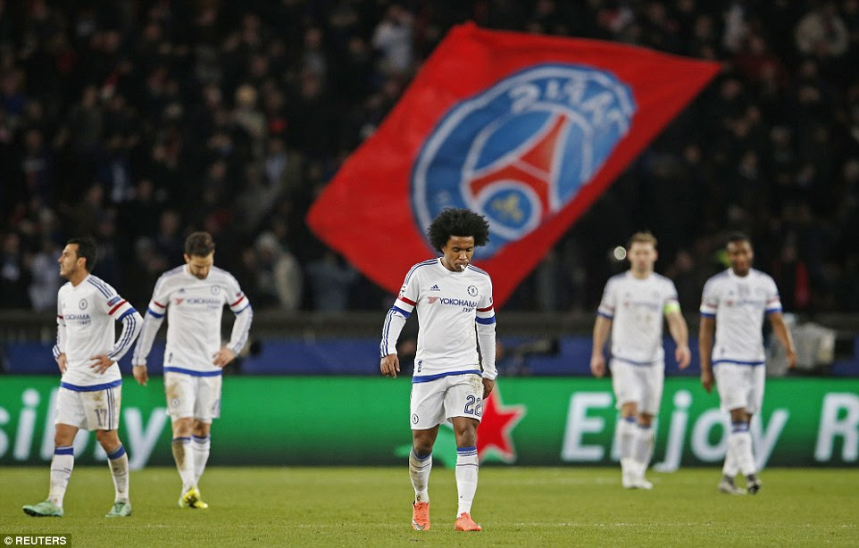 Chelsea players look dejected as they trudge back to the halfway line following Cavani's late winner for the home side