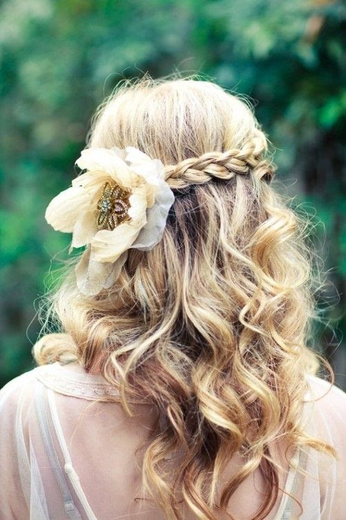 Messy curls. Simple braid. Big flower.