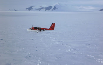 A Twin Otter aircraft on snow covered ground