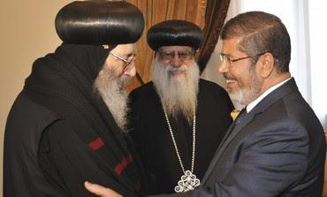Mohamed Mursi greets Coptic Bishop Beshoy