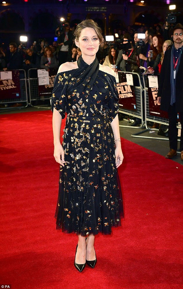 French fancy: Cinching in just above her bump, the dress flared out to ankle length, exposing a pair of patent black court shoes as she teetered into the Leicester Square Odeon