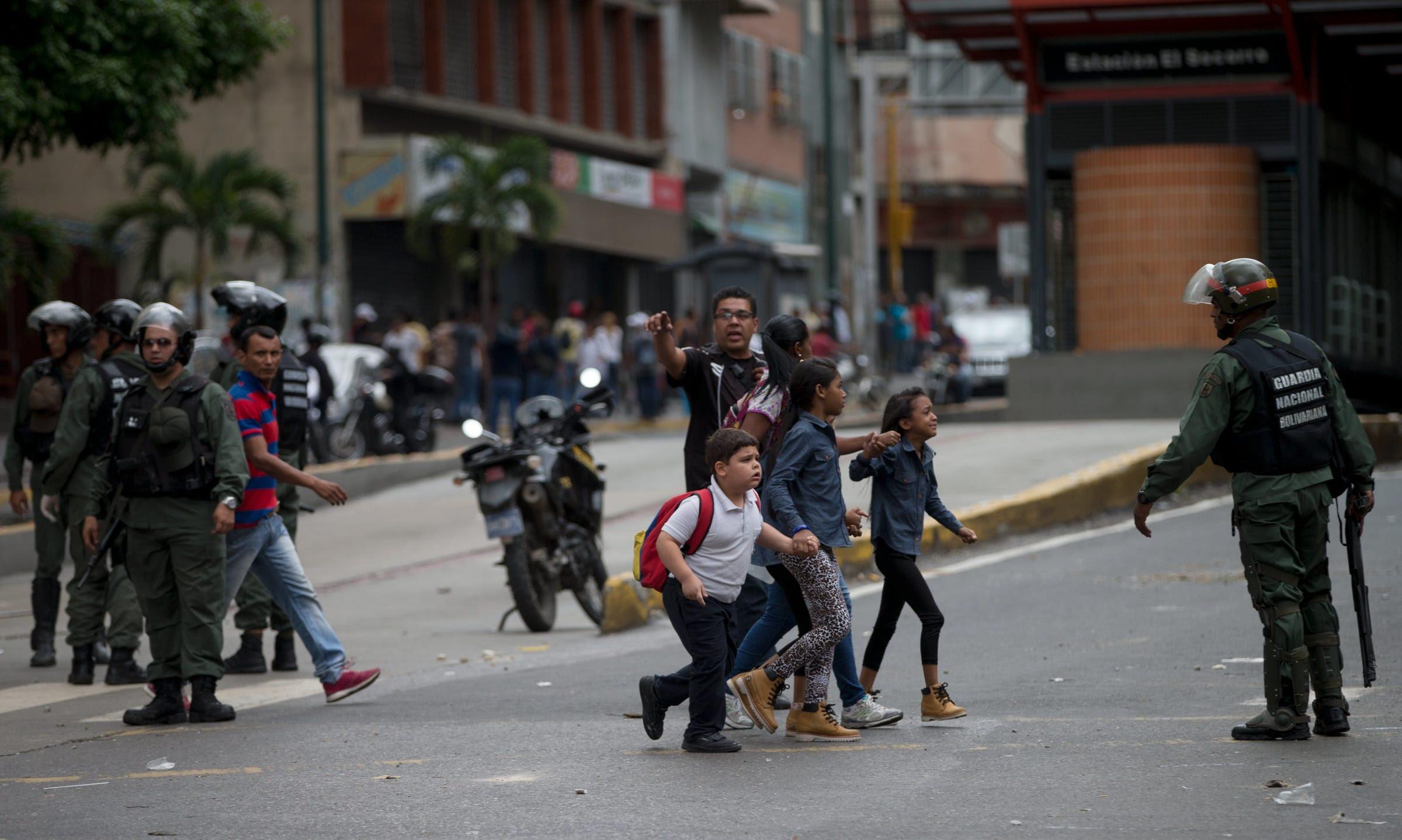 Venezuela police riot protest Caracas
