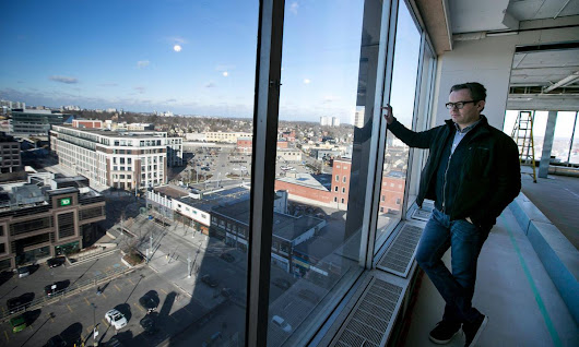 From Perimeter Development's nearly completed building at 345 King St. W. in Kitchener, Ont., partner Craig Beattie has a good view of the parking lot where the company's new six-storey office tower will be built.