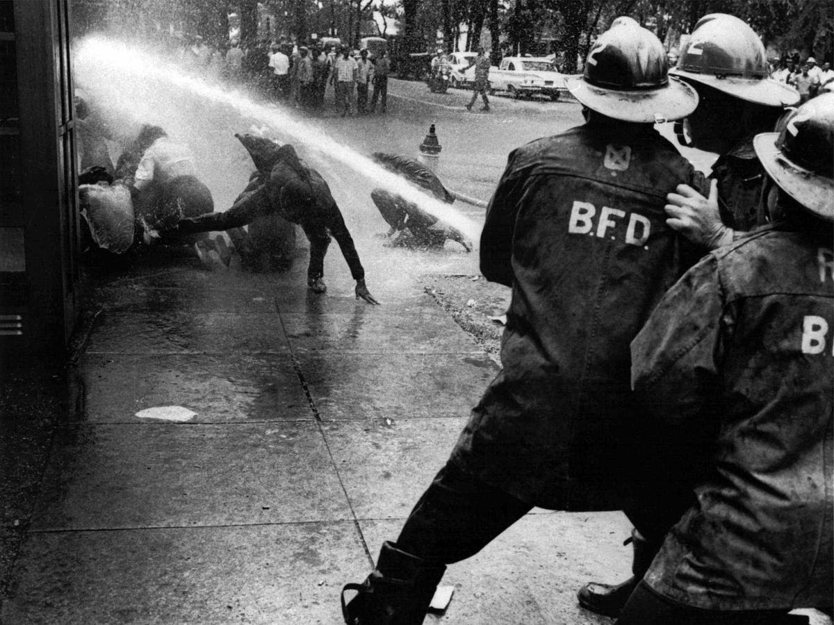 "The situation in the South continued to worsen. Below, firefighters in Birmingham turn a high-powered hose on peaceful demonstrators. Bayard Rustin, the march's head organizer, said that credit for mobilizing the march could go to ""Bull Connor [Commissioner of Public Safety in Birmingham], his police dogs, and his fire hoses."""