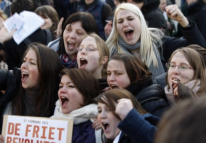 Students cheer as they protest in Brussels, Thursday, ...