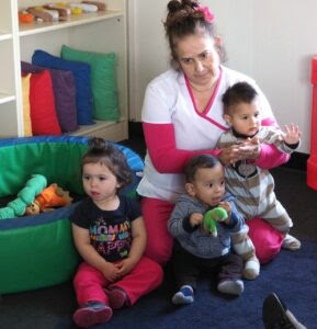 The required ratio of children to daycare teacher is three to one. Daycare teacher Belia Fuentes has her hands full with Xochitl Anaya, left, Nathan Guzmán and Ivan Castillo at the Pajaro Valley Unified's daycare center in Watsonville.