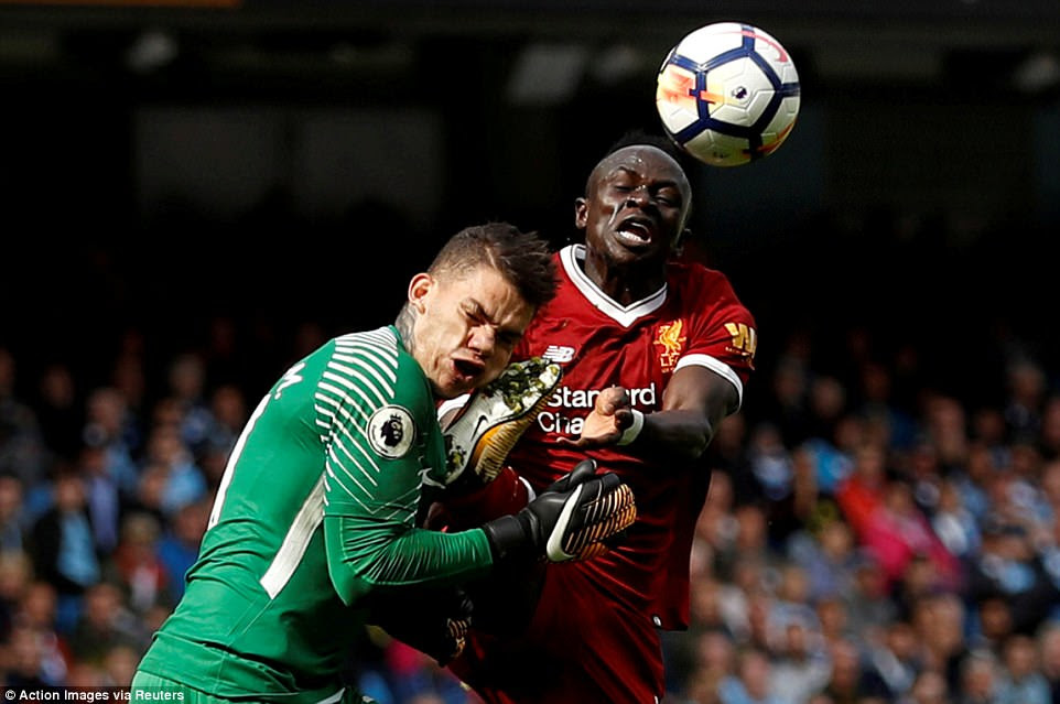 Manchester City's Ederson Moraes (L), is fouled by Liverpool's Sadio Mane at the Etihad Stadium in Manchester on September 9. Mane was handed a red card for the foul and was sent off in accordance with the rules