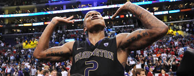 Washington Huskies guard Isaiah Thomas (2) celebrates after making the game winning shot in the 2011 PAC-10 basketball tournament championship game against the Arizona Wildcats at the Staples Center. The Washington Huskies won 77-75. Mandatory Credit: Mandatory Credit: Kelvin Kuo-US PRESSWIRE