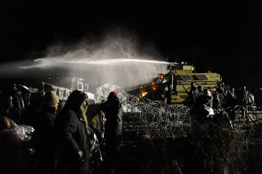 Police defend use water cannons on Dakota Access protesters in freezing weather