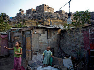 Children play near their home in the Duweika area of Cairo