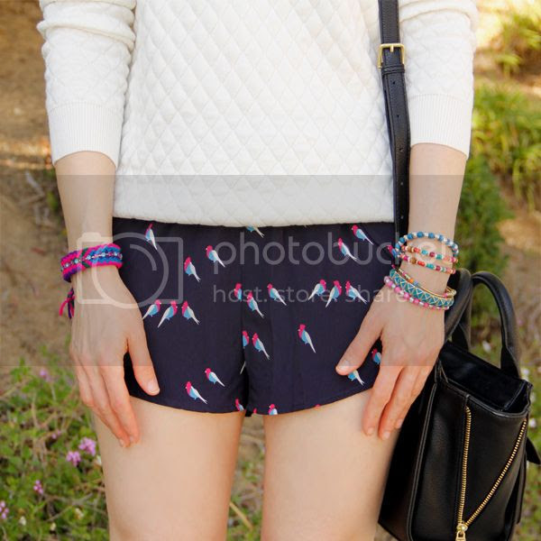 LA fashion blogger The Key To Chic wears an Xhilaration quilted sweater with Grayson Shop parrot printed shorts