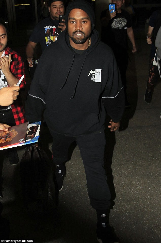 Taking to Twitter again: Kanye West has used social media to make an indirect apology for dragging Amber Rose and Wiz Khalifa's son into his war of words - he is seen here at LAX on Friday