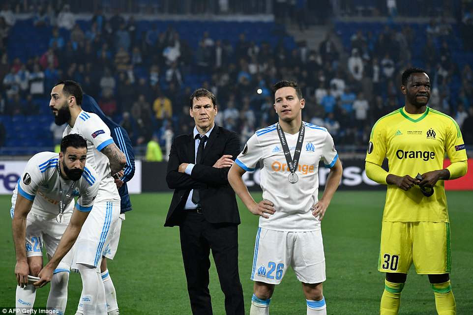 Marseille manager Rudi Garcia (centre) watches on with his players as Atletico go up to receive their trophy