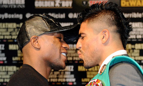 Floyd Mayweather and Victor Ortiz at news conference before their fight in Las Vegas