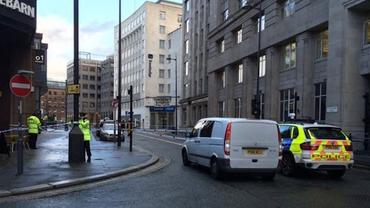 Liverpool bomb scare: Man detained after office alert - BBC News