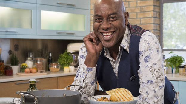 Ainsley Harriott's salmon burgers in a ciabatta bun with ...
