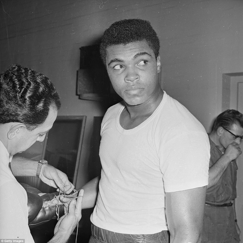 Back in June 1963, Ali has his gloves tied before a bout with Britain's Henry Cooper, which he won inside five rounds at Wembley