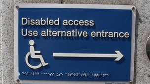 Disabled access sign, in braille