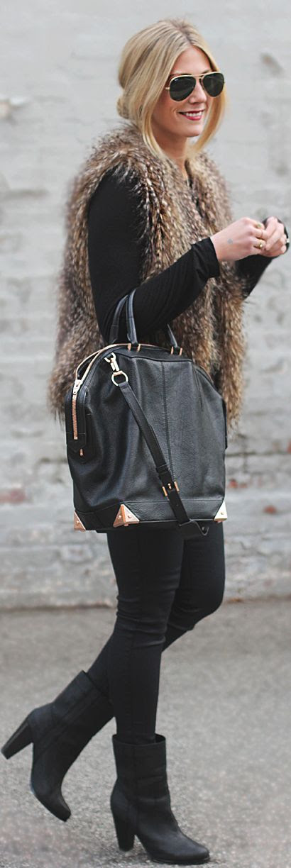 Add a fur vest to an all black outfit. #furvest Get the look here---> http://handinpocket.com/bb-dakota-lida-fur-sweater-vest.html