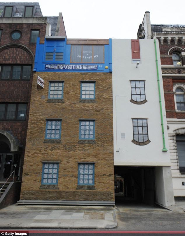 Artist Alex Chinneck turns the world on its head by creating this upside-down house in London
