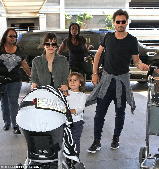 Jet setters: Kourtney, Scott, Mason and Penelope were seen heading out to catch a flight