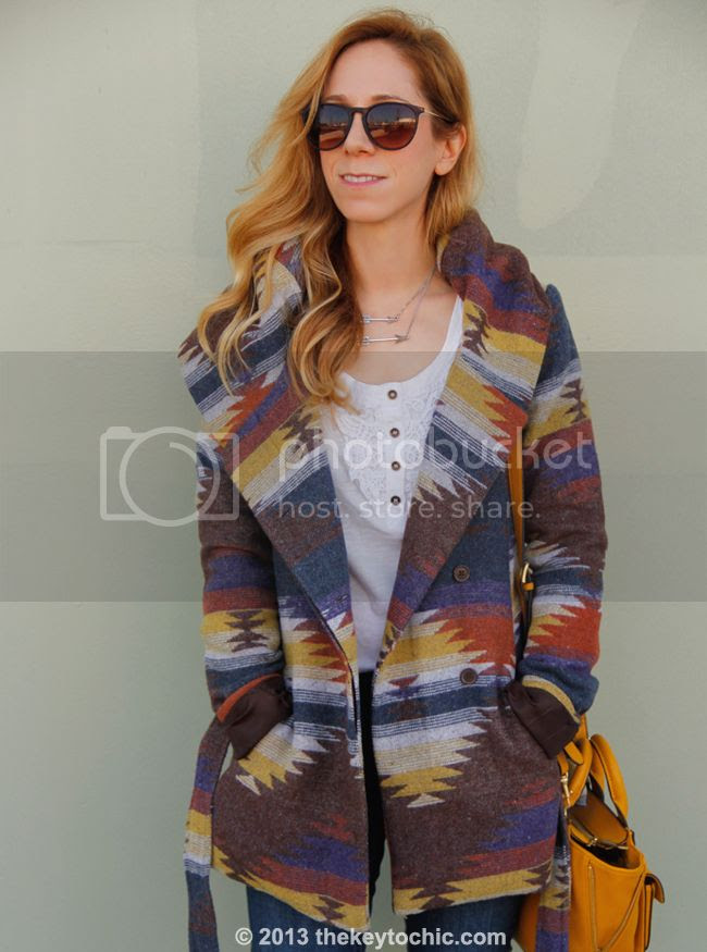 L.A. fashion blogger The Key To Chic wears Old Navy Rockstar jeans,a Phillip Lim for Target mini satchel, and a Mossimo blanket print Western wrap coat