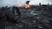 MH17 tragedy:    No leads yet as investigators comb through Malaysian plane crash site; at least 298 killed