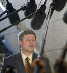 Prime Minister Stephen Harper speaks with the media in the House of Commons in Ottawa Thursday after the government failed to pass a motion to reopen same-sex marriage legislation.