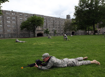 Members of the class of 2013 at the United States Military Academy practice for coming military maneuvers in the field.
