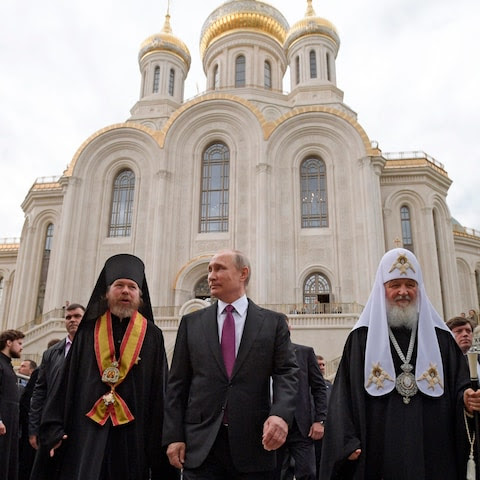 Bishop Tikhon and Patriarch Kirill accompany Vladimir Putin on a visit to the Sretensky Monastery in Moscow in May.