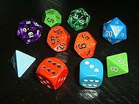 Typical role-playing dice, showing a variety of colors and styles. Note the older hand-inked green 12-sided die (showing an 11), manufactured before pre-inked dice were common. Many players collect or acquire a large number of mixed and unmatching dice.