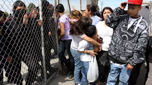 Families gather outside a prison in northern Mexico after it was announced that scores were killed in a rebellion. by Pan-African News Wire File Photos