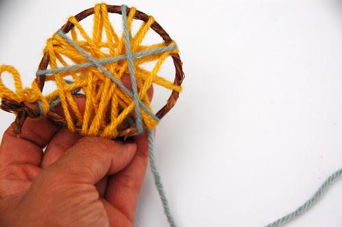 making a little yarn ornament