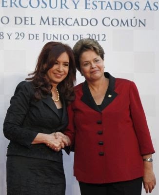 Presidents Cristina Fernandez of Argentina and Dilma Rousseff of Brazil at a summit of Latin American leaders to discuss the political coup against Fernando Lugo in Paraguay. The gathering (Mercosur) suspended the country from the regional community. by Pan-African News Wire File Photos