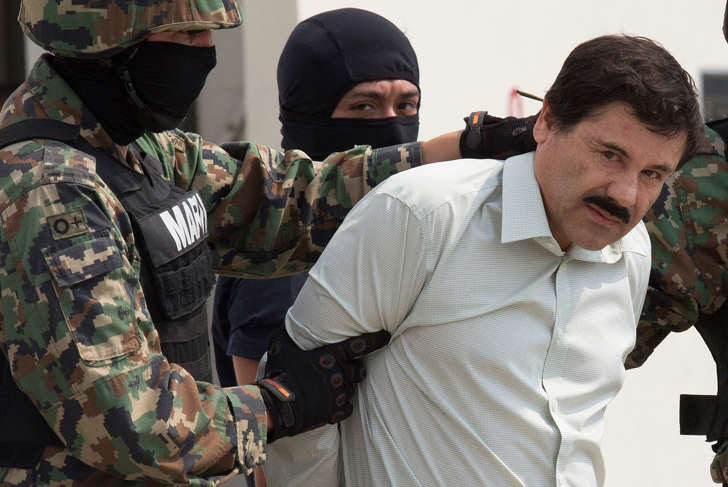 The drug trafficker Joaquin Guzman Loera, El Chapo guarded by members of Mexican Navy after being arrested at a hotel in Mazatlan, Sinaloa in Mexico city, Mexico, on Saturday, Feb. 22, 2014. Interpol has issued a red notice for the Mexican drug lord who escaped from a maximum security prison in Mexico last weekend.
