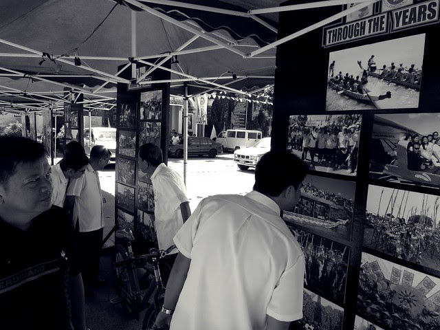 Municipal employees of Candaba looking at pictures of their town's milestones.  Photographed by Bernard Eirrol Tugade
