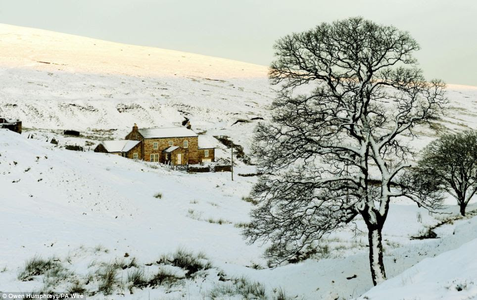 Winter arrives: The unseasonably mild winter gave way to cold and snow which turned Carr Shields, Northumberland, pictured, into a picturesque snowy scene