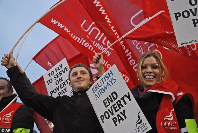 Employees of British Airways hold posters and banners as they start the 48-hour cabin crew strike at Heathrow Airport in London