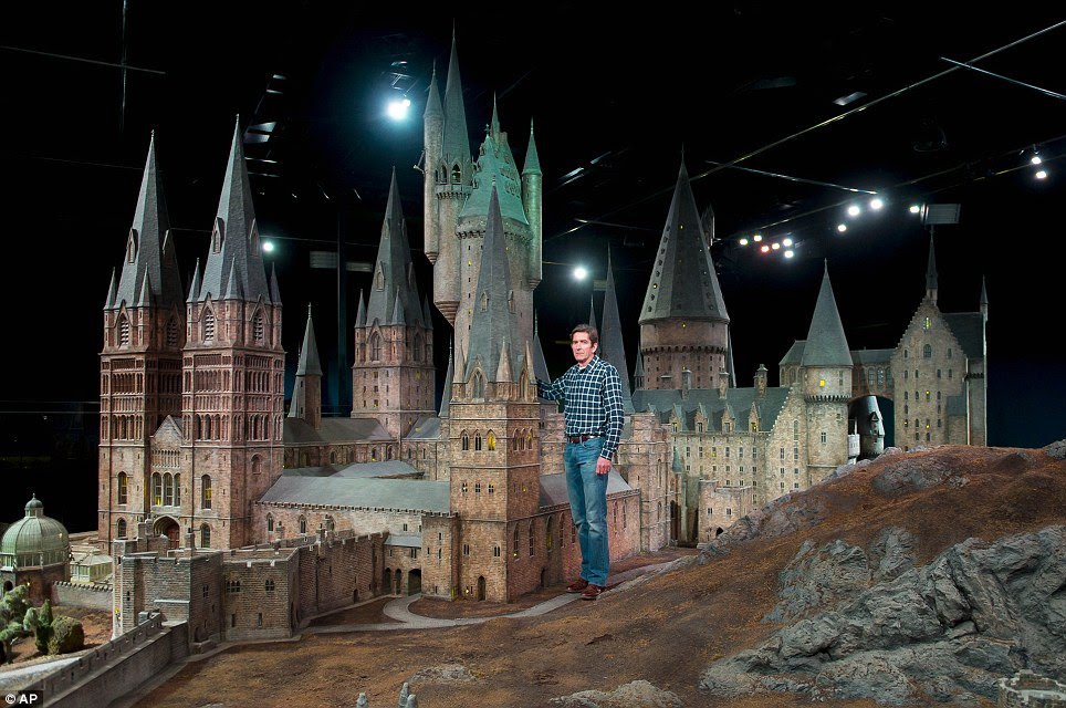 Proud: Jose Granell, model supervisor, is pictured with the model of Hogwarts Castle. It has been used for every one of the Harry Potter films