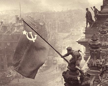 Soviet soldiers raise the flag over the Reichstag in Berlin, 1945