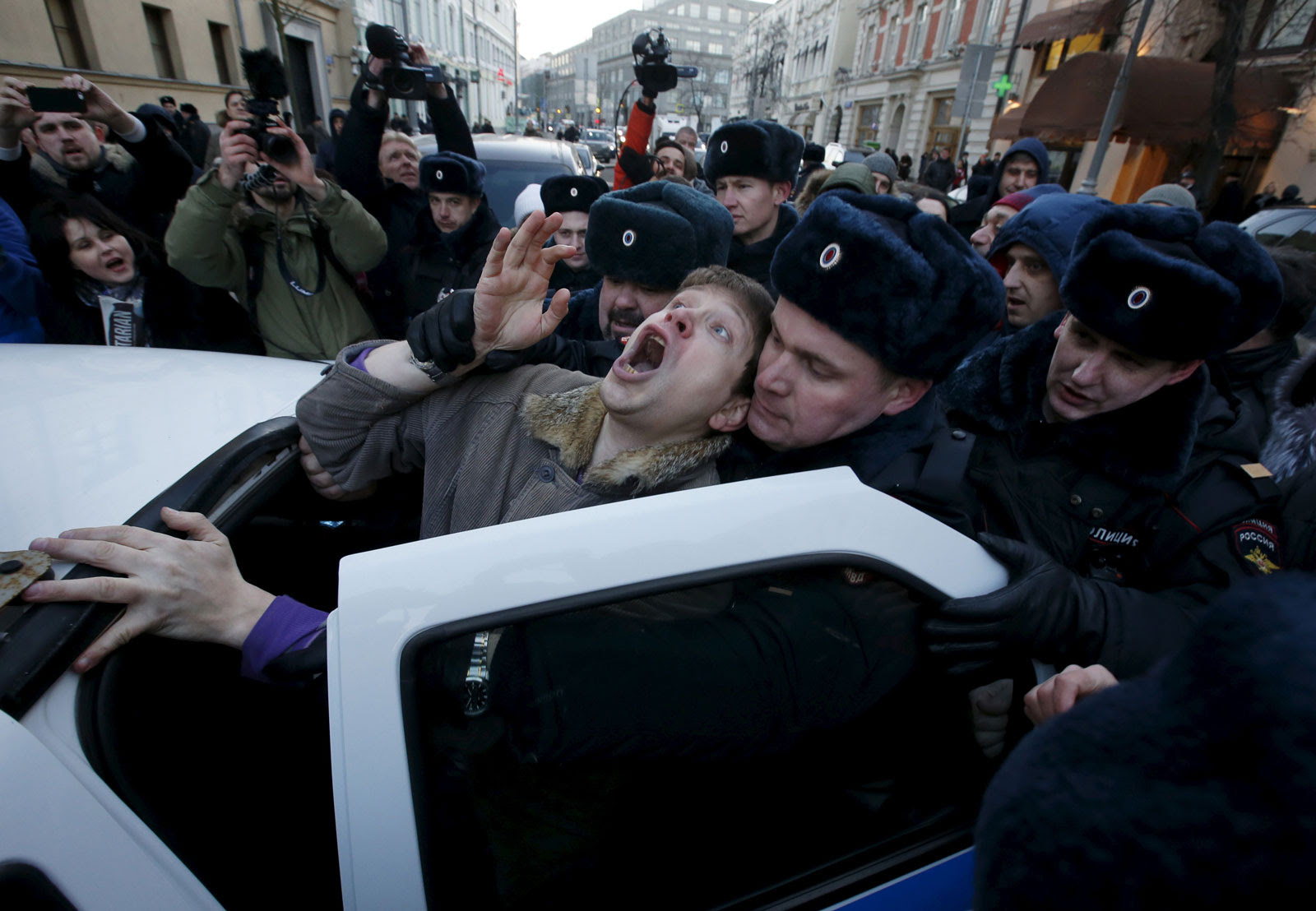 Police officers detain an activist who was taking part in a rally of foreign currency mortgage holders, near the Central Bank headquarters, Moscow, Russia, February 8, 2016