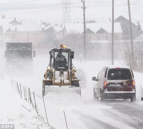 A snow truck removes snow from the road near the village of Dardhishte, Kosovo