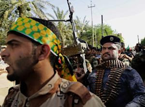 FILE - In this Monday, June 16, 2014 file photo, Shiite…