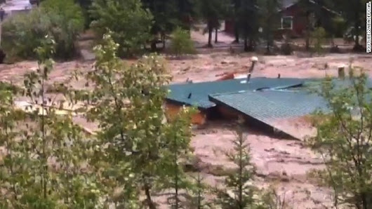 'The roar of the river is terrifying,' Alberta's premier says after flood tour